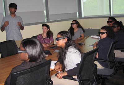 Institute postdoctoral associate Sweta Vangaveti shows Troy Prep School 6th graders 3D RNA simulations.