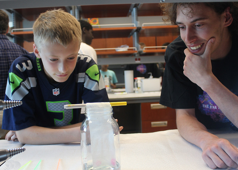 Angelo Setaro, a UAlbany master's student in chemistry, works with a Consortium student.