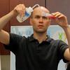 RNA Institute research scientist Ken Halvorsen demonstrates a strawberry DNA extraction.