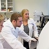 Spencer Weintraub and Janeen Bell,  undergraduate students, Kyla Frohlich, Ph.D., Lab Manager,  Agris Lab