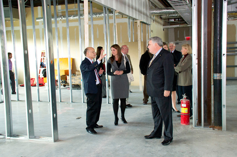 RNA Institute Director Paul Agris gives Assemblymember Jack McEneny and others a tour of the The RNA Institute shell space during construction.<br /> Photographer: Mark Schmidt