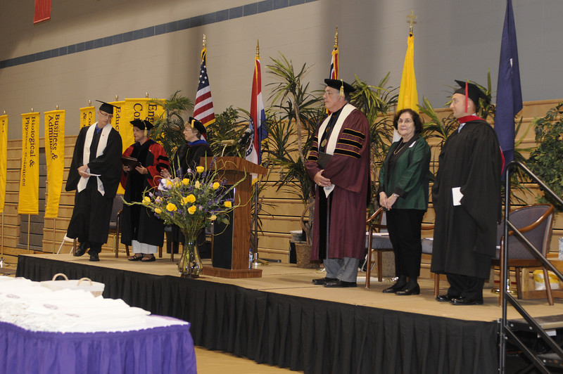 Andy Dusanowsky steps forward to open the Convocation ceremony.