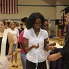 A student recieving her convocation pin.