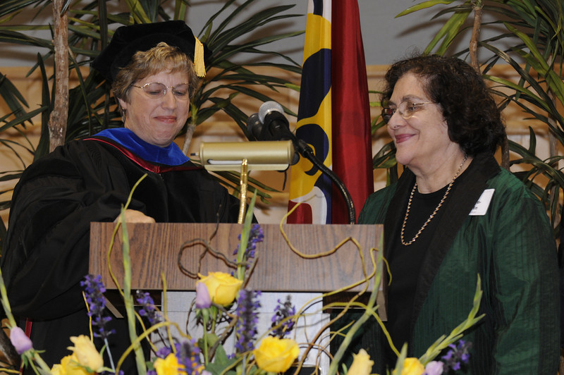Dr. Nancy Blattner presents Batya Abramson-Goldstein with her award.