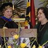 Dr. Nancy Blattner presents Batya Abramson-Goldstein with her award.