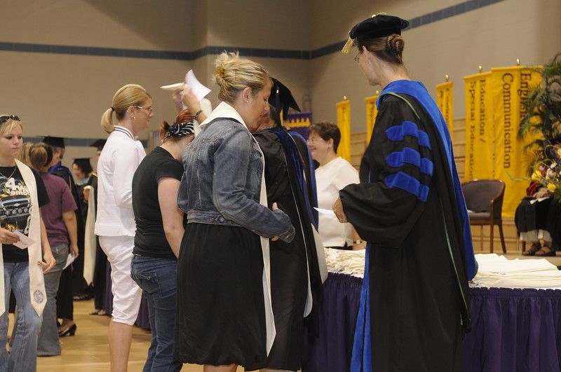 First time Convocation attendees recieve stoles from the faculty.