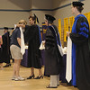 Faculty place stoles on students who attend the Convocation Ceremony for the first time.