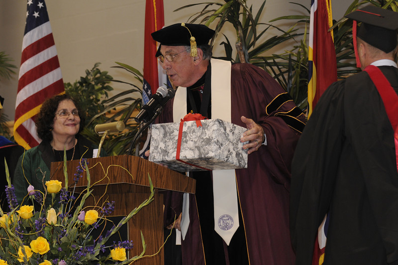Dr. Dennis Golden presents Batya Abramson-Goldstein with a gift from the University.