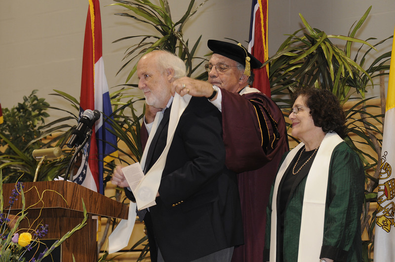 Dr. Dennis Golden awards his close friend, Peter O'Connell, with a stole at the Convocation ceremony.