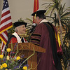 Dr. Dennis Golden thanks Dr. Ada Maria Isasi-Diaz and presents her with a stole a Batya Abramson-Goldstein looks on.