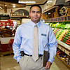 Manager\ in\ produce\ section\ of\ grocery\ store\,\ portrait