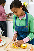 Girl working in kitchen with her mother