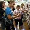 Students at Whole Foods reviewing product labels