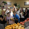 Students having fun with their fruits at Whole Foods.