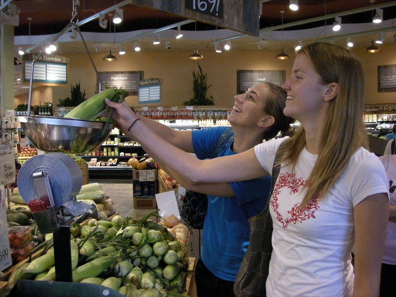 Students weighing food at Whole Foods.