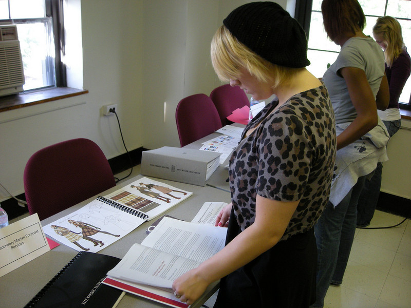 Fashion student reviewing materials