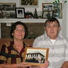Rešad and Sabiha Kulenović in St. Louis in 2007.  Sabiha is holding a photograph of her girlhood home, which was destroyed in 1992. Photograph by Benjamin Moore.