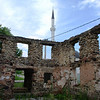 Ruins of mosque destroyed in Hambarine in 1992; the minaret from a new mosque rises in the background.
