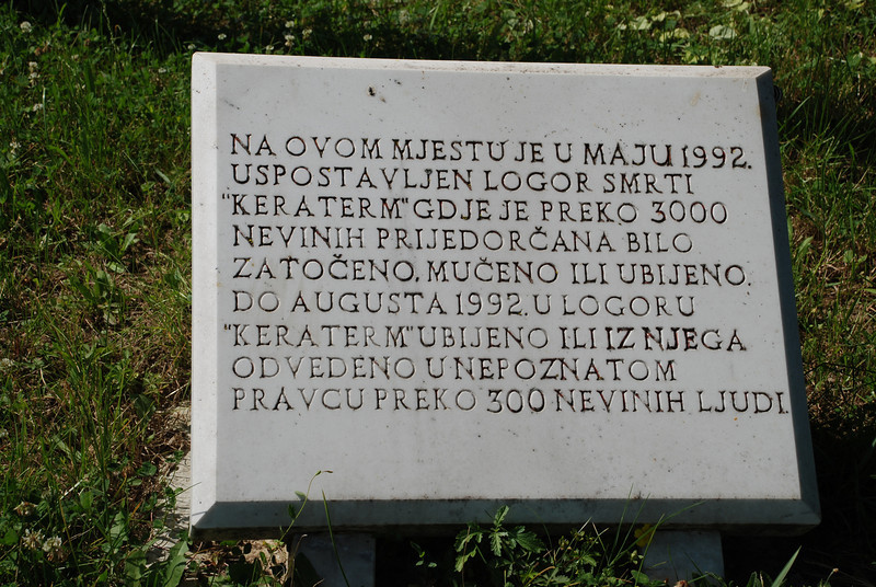 "The inscription on the tablet reads, ""On this site in May 1992 the death camp 'Keraterm' was established where over 3000 innocent Prijedorians were imprisoned, tortured, or killed until August 1992.  Over 300 innocent people in the camp 'Keraterm' were killed or taken to unknown locations."" Photograph by Patrick McCarthy."