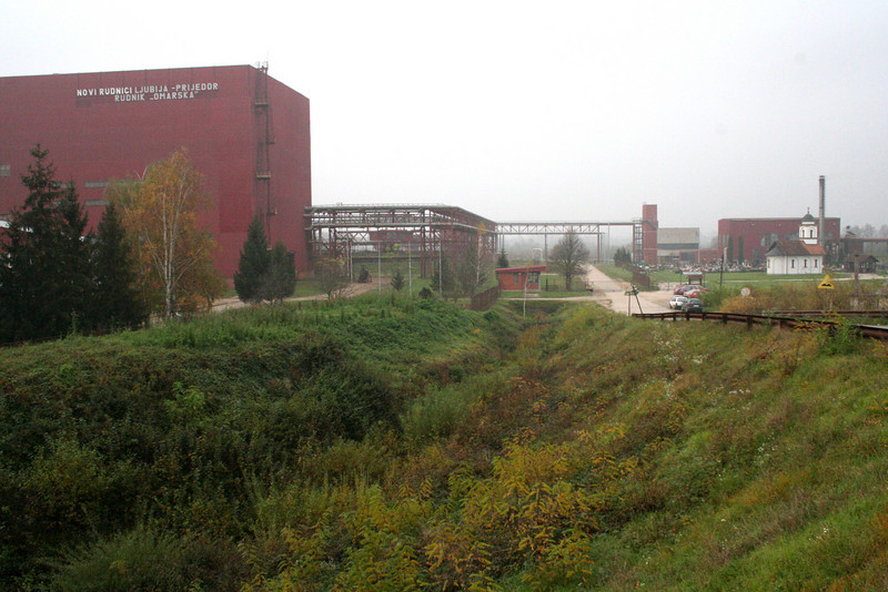 The Omarska mine complex is now owned by Mittal Steel, the world's largest steel producer.  Many believe that victims' bodies—perhaps hundreds of them—are still buried in the sprawling complex.  There is currently no memorial at Omarska to the victims of the genocide.  Photograph by Doug Hostetter.