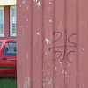 """A Serb nationalist symbol spray-painted on a wall in Prijedor; photographed June 2007. CCCC is often explained as meaning """"само слога србина спасава"""": """"only unity can save the Serbs."""" Photograph by Benjamin Moore."""