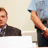 Bosnian Serb Zeljko Meakic in the courtroom of the International Tribunal for the Former Yugoslavia for his initial appereance in The Hague 07 July 2003. According to the indictment, Meakic was the Commander of the Omarska prison camp during the Bosnian war. He pleaded not guilty to war crimes.AFP Photo/Dusan Vranic/POOL  (Photo credit should read -/AFP/Getty Images)