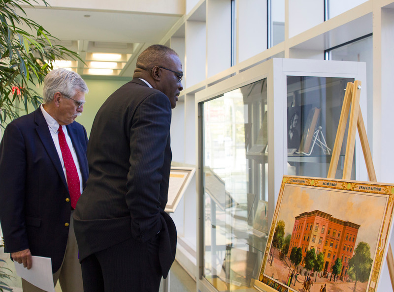 As part of Celebrate and Advance UAlbany week, university archivist Geoff Williams guides President Jones through a historical exhibit of the university in the Science Library atrium.  Photographer: Paul Miller