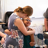 Master's student Chelsea Bonaker gets a hug.