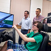 University of West Florida undergraduate psychology major Zachary Yount takes a spin in the Driving Simulator as psychology graduate student Jared Van Dam and Dr. Steve Kass record the results.