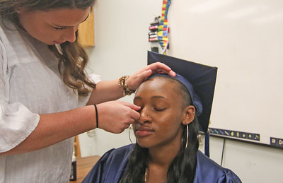Kate Gronert helping Ai'Veona Brown with her makeup. The 2019 commencement ceremony at Academy Charter High School in Lake Como, NJ on 6/20/19. [DANIELLA HEMINGHAUS | THE COAST STAR]