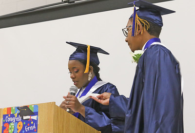 Salutatorian, Nathaniel Humphrey giving Valedictorian Fabienne Cetoute a tissue during her emotional speech. The 2019 commencement ceremony at Academy Charter High School in Lake Como, NJ on 6/20/19. [DANIELLA HEMINGHAUS | THE COAST STAR]