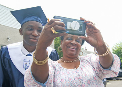 Nasheem Nance with his grandmother, Kelly, taking a selfie. The 2019 commencement ceremony at Academy Charter High School in Lake Como, NJ on 6/20/19. [DANIELLA HEMINGHAUS | THE COAST STAR]