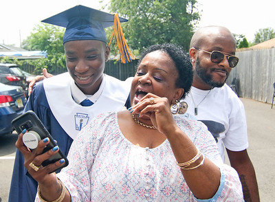 Nasheem Nance with his grandmother, Kelly, and dad, Gordon. The 2019 commencement ceremony at Academy Charter High School in Lake Como, NJ on 6/20/19. [DANIELLA HEMINGHAUS | THE COAST STAR]