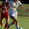 Notre Dame Academy girls soccer player junior Keely Ford takes the ball down field during their match up with Innovation Academy Charter School on Monday afternoon in Tyngsboro. Trying to chase her down is IACS player Isabela Schmalz. SUN/JOHN LOVE