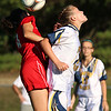Notre Dame Academy girls soccer player sophomore Linsey Former tries to head the ball with Innovation Academy Charter School player Sarah Milne on Monday afternoon in Tyngsboro. SUN/JOHN LOVE