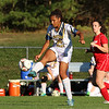 Notre Dame Academy girls soccer player junior Maya Wilson  sends the ball down field during their game with Innovation Academy Charter School on Monday afternoon in Tyngsboro. SUN/JOHN LOVE