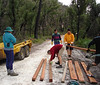 Preparing and cutting the boardwalk sections before hauling them up the track.