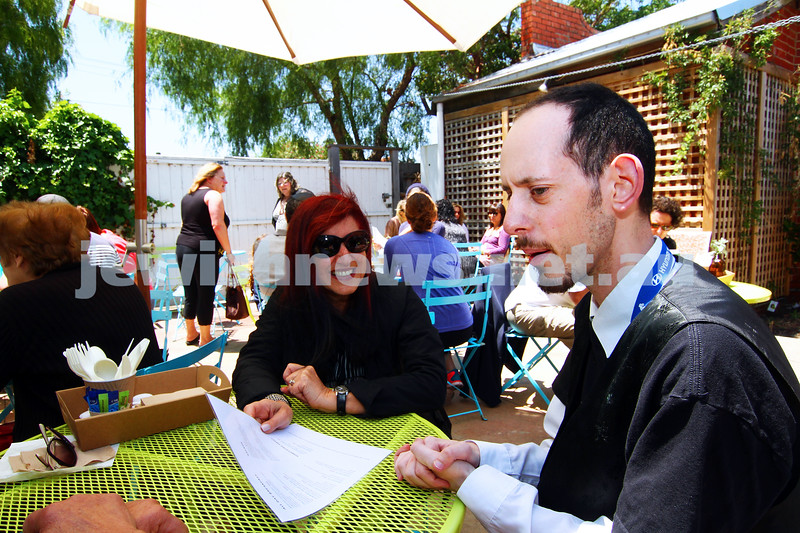 28-11-14. Access Inc. Pop up cafe. Josh Ferenbach, maitre de of the cafe chats to some of the customers. Photo: Peter Haskin