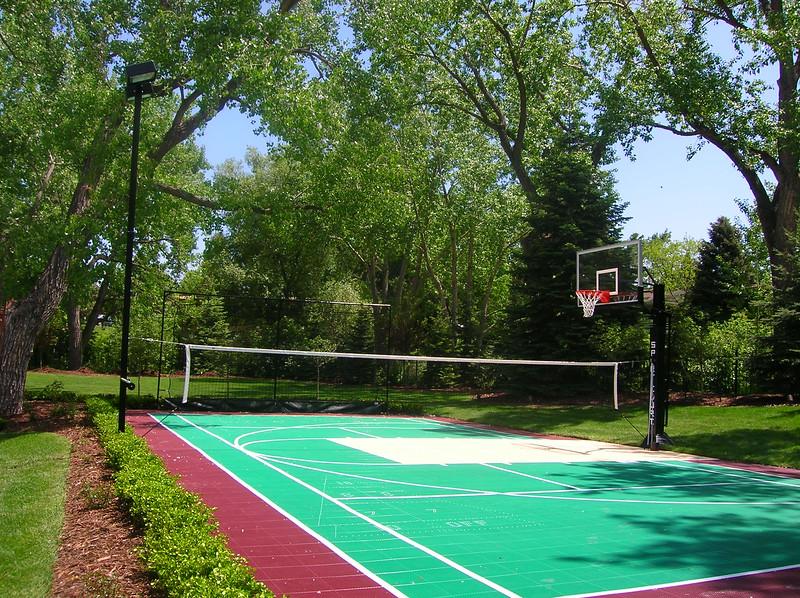 Backyard Court_burgundy, evergreen, sand