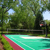 Backyard Court_burgundy, evergreen, sand