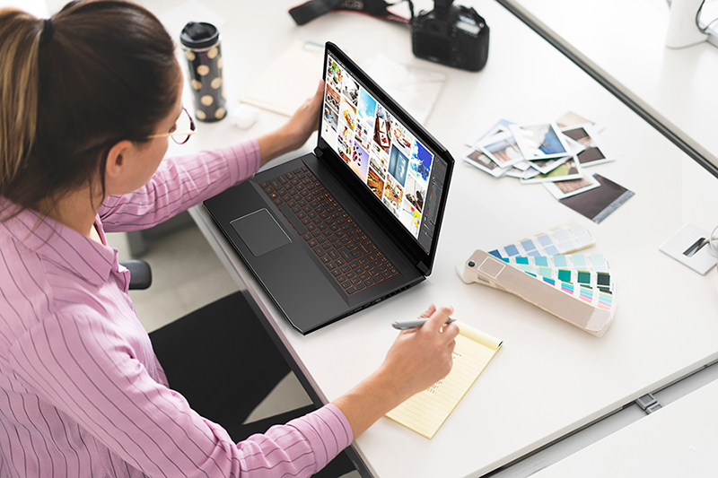Designer working in office, using laptop