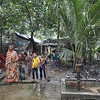 Nur and her husband with the neighbours. The handpump next to them is contaminated with arsenic so they have to collect drinking water from another handpump. South Katia outside Jessore town.