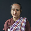 Ripa Pandit, 25 years old. Netrokona, Shotrosri village.<br /> <br /> Ripa got married in 2015. The marriage with her husband was arranged by the two families. Her family-in-law wanted 4 lakh (400,000 Taka, 4800 USD) in dowry from Ripa's father, but he was poor and could not afford the payment. The family-in-law wanted the money before the marriage. However, they got married, and Ripa's father left her at her new family-in-law's house in Kishorgunj district.<br /> Four days after the marriage, the father-in-law, mother-in-law, her new husband and two other family-in-law members came to the room, where Ripa was sleeping at the family-in-law's home. In the night on 26th July 2015 2:00 pm, the five persons attacked and held Ripa tight while they forced her to drink corrosive acid. Her husband's sister and his uncle also helped planning the acid attack on Ripa.<br /> <br /> Today, Ripa has very serious internal injuries from the acid attack. Her esophagus is completely damaged by the strong corrosive acid. Ripa can no longer drink or eat anything. She is surviving getting liquid and food through a tube that is inserted at the side of her stomach. Ripa is always carrying a small blender, and makes the food herself. She also carries a small plastic bucket for her spit. Ripa has respiratory problems, asthma and other health complications after the acid attack. 7-8 months after the acid attack, she was not able to speak, but now it is better.<br /> <br /> Ripa is too weak and has not sufficient energy to work. She can only prepare her own food so that she can survive. After the acid attack, a lot of problems erupted in her family. Her father got a serious stroke, and her mother is also weak. Ripa needs a special and complicated operation that cannot be done in Bangladesh. She hopes that one day someone will help her getting an operation abroad. That's her dream.<br /> <br /> Ripa and her family filed a case with the police against her family-in-law, who committed the crime.