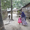 Rajia on her way into her paternal home in Mokarran village outside Monirampur.