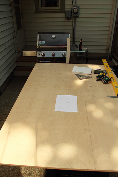 Measured and drew the outline of the sides. Grill in the background is cooking up lunch.
