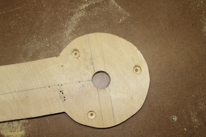 In order to cut holes for the speaker panel, I needed to create a circle jig. I created it with this piece of 1/2 inch plywood. I traced the plunge base's plate, cut a middle hole, and drilled a hole for the screws (using a larger bit at first because the screws wouldn't have been long enough).