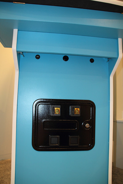 Coin door, power button, and USB ports