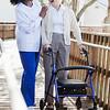 Nurse helping senior woman with walker