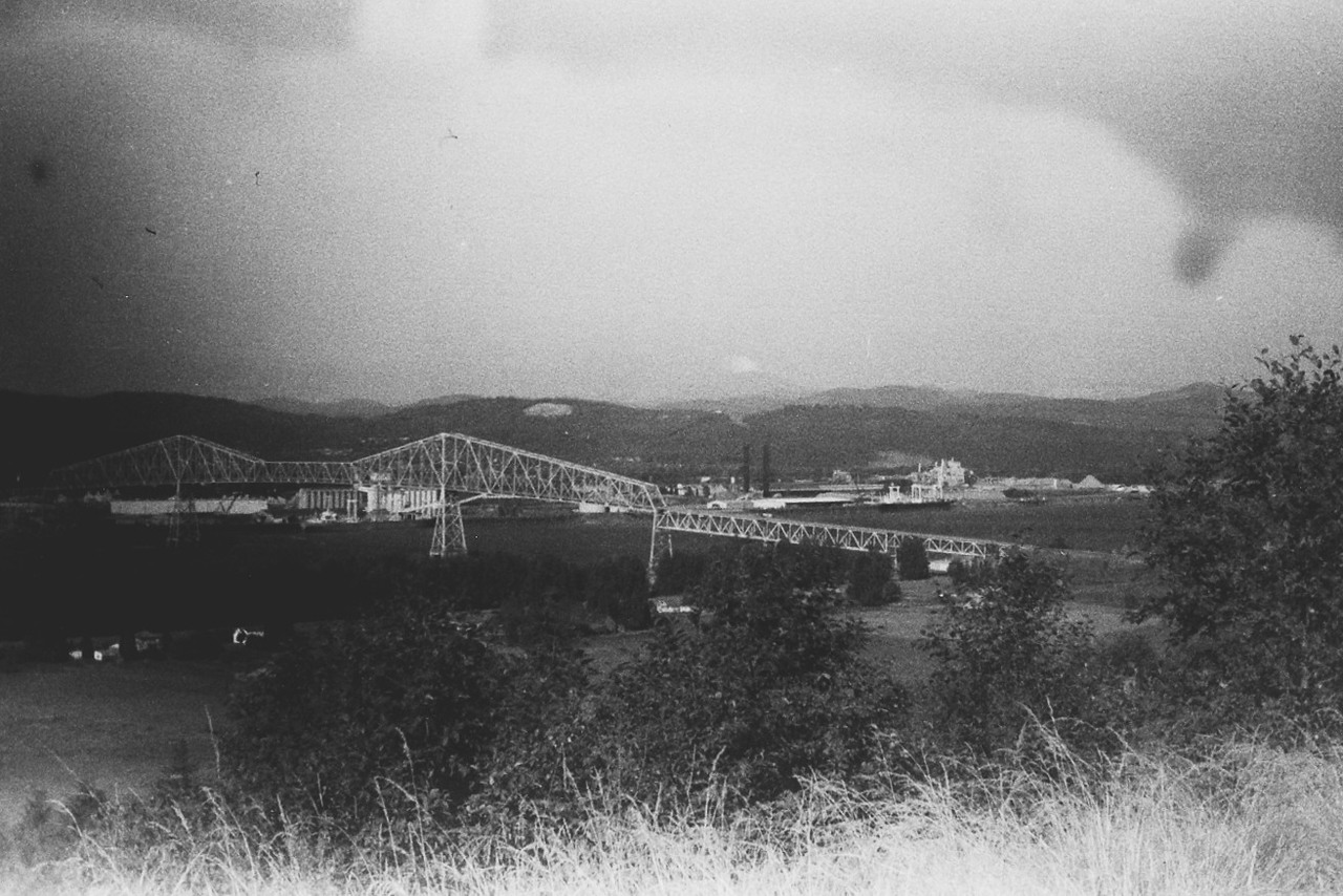 Longview bridge is in the foreground; Mt. St. Helens is beginning its eruption in the background