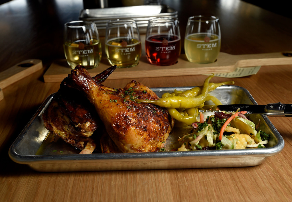 . Organic half chicken with house-made slaw and basque peppers at Acreage by Stem Ciders restaurant on Thursday in Lafayette. For more photos of the restuarant and the food go to dailycamera.com Jeremy Papasso/ Staff Photographer 04/12/2018